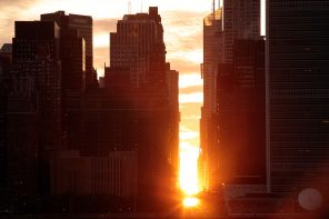NEW YORK, NY - JULY 11: A view of the 'Manhattanhenge' sunset from Hunters Point South Park, July 11, 2016 in the Queens borough of New York City. 'Manhattanhenge' is created when the setting sun aligns with the city's street grid. (Photo by Drew Angerer/Getty Images)