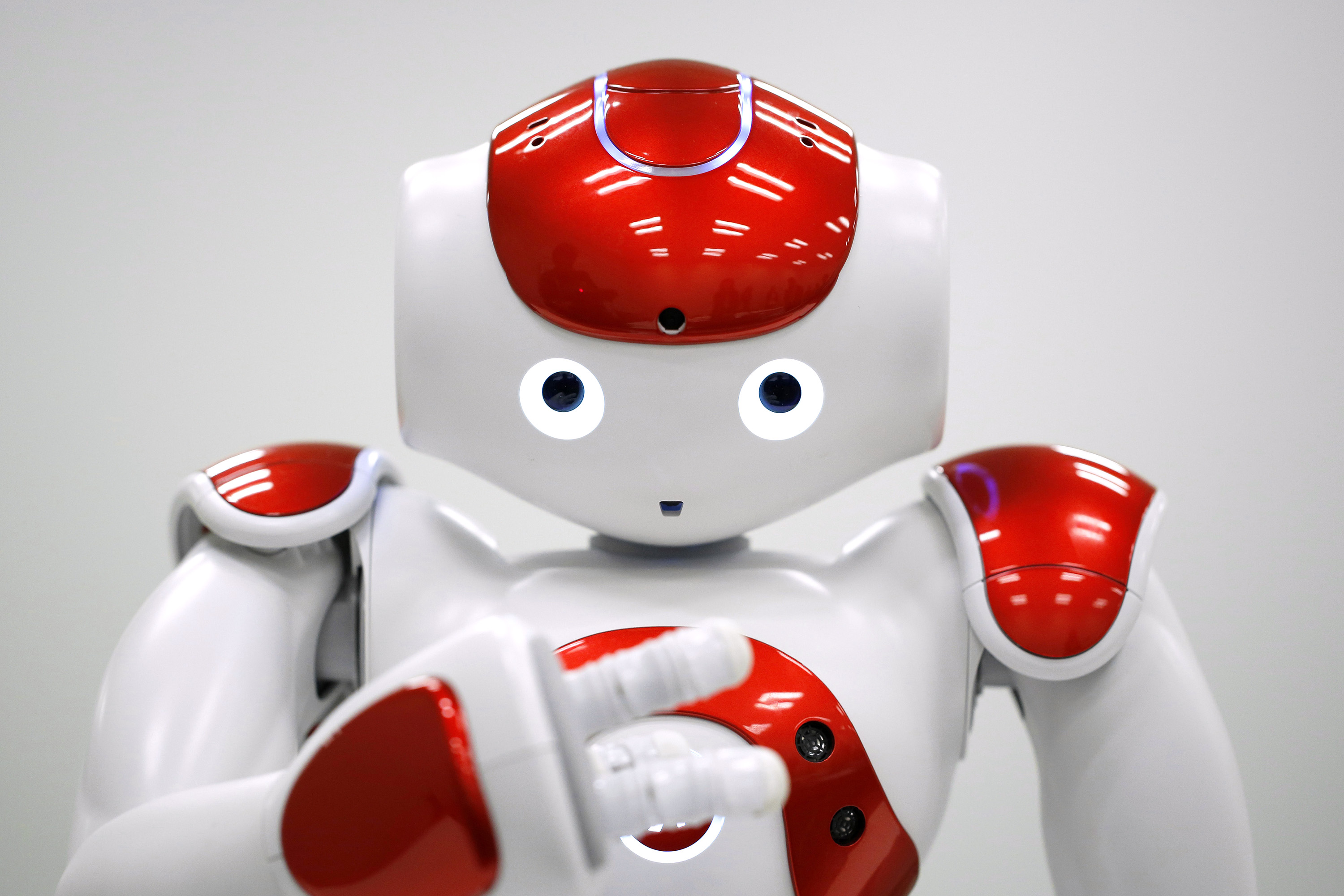 Bank of Tokyo Mitsubishi UFJ Ltd. Demonstrates Nao Robot Clerk To Be Used In Bank Branches