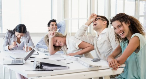 Casual business team laughing during meeting