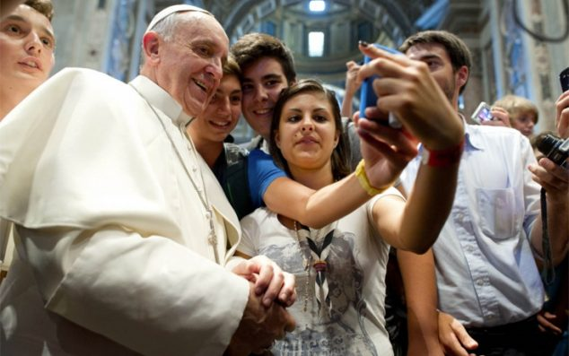 Everyone wants a papal selfie, including youth from the Italian Diocese of Piacenza and Bobbio on Aug. 28, 2013. (L'Osservatore Romano)