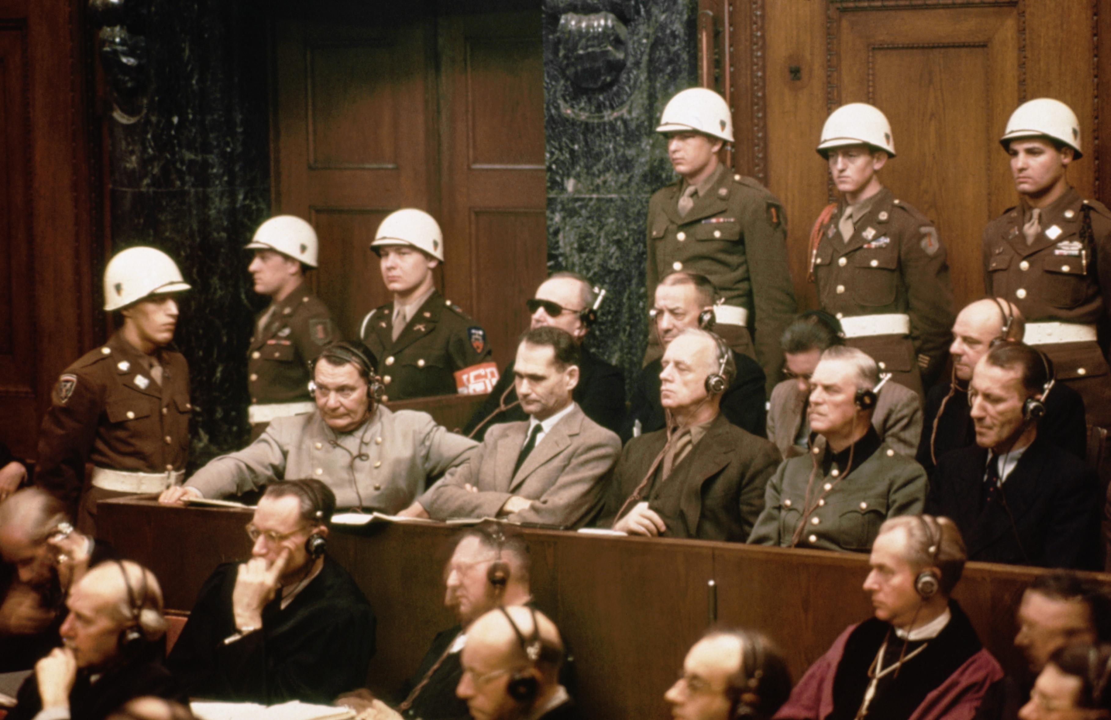 01 Jan 1946, Nuremberg, Germany --- The defendants at the Nuremberg Nazi trials.  Pictured in the front row are: Hermann Goering, Rudolf Hess,  Joachim Von Ribbentrop, Wilhelm Keitel and Ernst Kaltenbrunner.  In the back row are: Karl Doenitz, Erich Raeder, Baldur von Schirach, and Fritz Sauckel. --- Image by © Bettmann/CORBIS