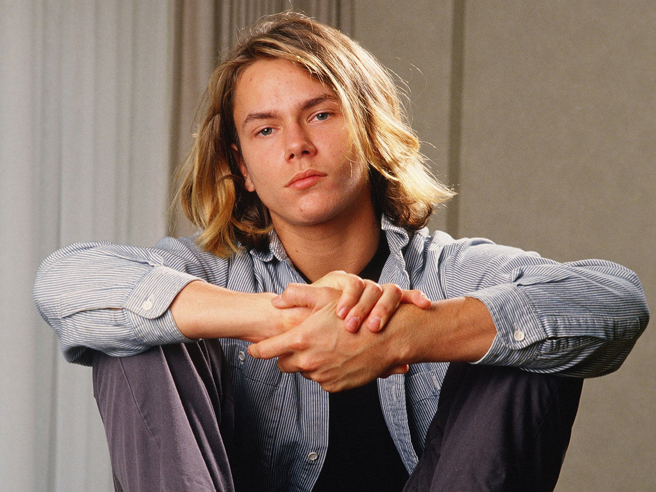 """FILE  October 30: On October 31, 2013 it will be the 20th anniversary of the death of actor River Phoenix. Known for his roles in 'Stand By Me', 'My Own Private Idaho' and 'Indiana Jones and the Last Crusade', Phoenix quickly became a teen sensation. He died at the age of 23 after suffering drug-induced heart failure caused by heroin and cocaine at the Viper Room, in West Hollywood, California.   Please refer to the following profile on Getty Images Archival for further imagery: http://www.gettyimages.co.uk/Search/Search.aspx?EventId=129902435&EditorialProduct=Entertainment&esource=maplinARC_uki_13oct LOS ANGELES, CA - 1988:  Actor River Phoenix, star of """"Stand By Me,"""" poses during a 1988 Los Angeles, California, photo portrait session. Phoenix, a rising young film star, tragically died in 1993 outside a Sunset Strip nightclub of a drug overdose. (Photo by George Rose/Getty Images)"""