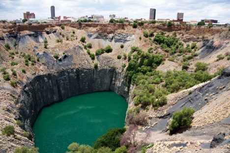 Daleen Loest big hole in kimberley, south africa, where De Beers diamond company originated and diamonds were dug out by hand. Largest man made hole on earth