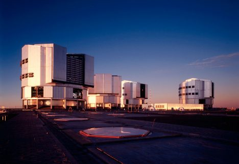 A view of the upper platform at the ESO Paranal Observatory with the four enclosures for the VLT 8.2-m Unit Telescopes and the partly subterranean Interferometric Laboratory (at centre). YEPUN (UT4) is housed in the enclosure to the right. This photo was obtained in the evening of November 25, 2001, some hours before