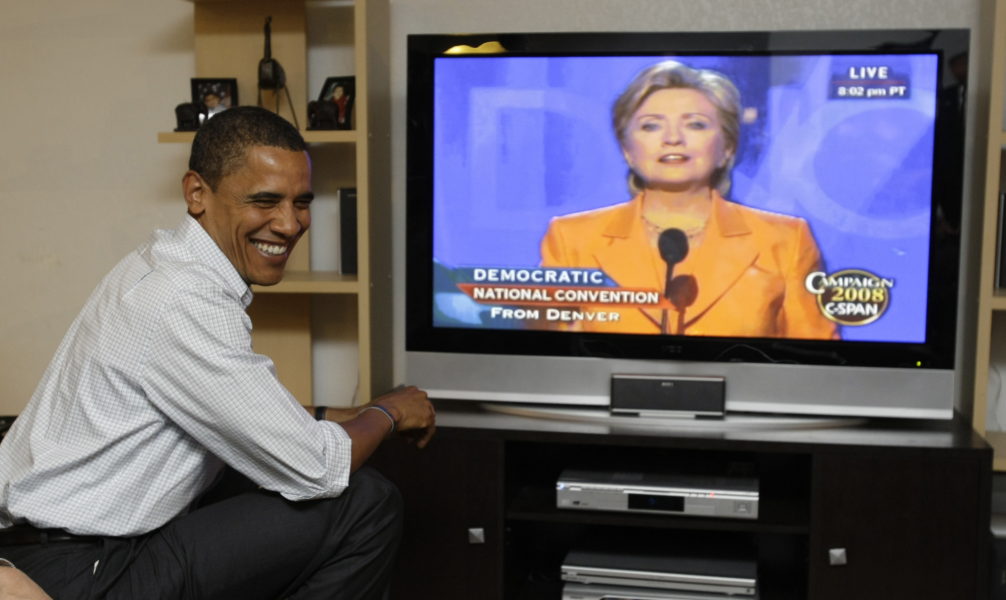 Democratic presidential candidate Sen. Barack Obama, D-Ill., watches Sen. Hillary Rodham Clinton, D-N.Y., speak at the Democratic National Convention from Billings, Mont., Tuesday, Aug. 26, 2008.(AP Photo/Alex Brandon)