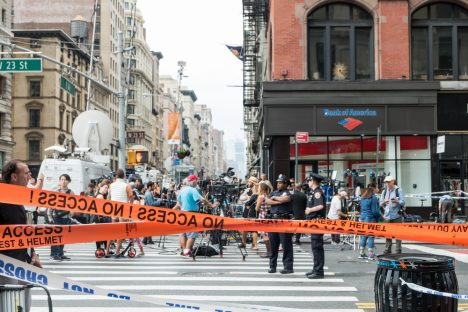 Supapun Narknimitrung Chelsea district, NEW YORK - September 2016 :Police Tape prevented pedestrians and News reporter to entering the blocked area which is the scene of Chelsea explosion.
