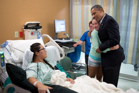 President Barack Obama hugs Stephanie Davies, who helped keep her friend, Allie Young, left, alive after she was shot during the movie theatre shootings in Aurora, Colorado, July 22, 2012. (Official White House Photo by Pete Souza)