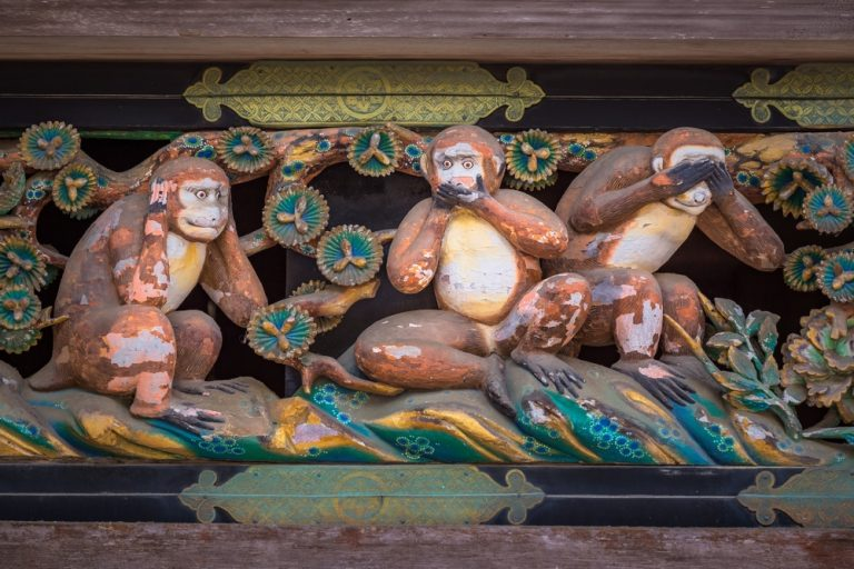 """Famous wood carvings """"see no evil, speak no evil and hear no evil"""" of the three wise monkeys at Tosho-gu wood carvings at a Store House in Nikko Tosgogu Shrine, Japan  Image ID:446145721 Copyright: Bule Sky Studio"""