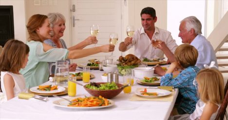 561717309-sunday-roast-dining-table-dinner-evening-meal-multi-generation-family