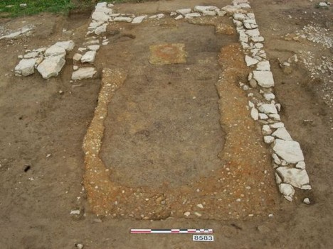The dining room of what might have been an ancient tavern, showing banks of pebbles where built-in benches once stood against the walls. (Photo: Lattes excavations)