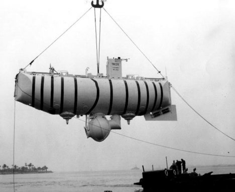 The Bathyscaphe Trieste is hoisted out of the water in a tropical port, circa 1958-59, soon after her purchase by the Navy. Photography was released by the U.S. Navy Electronics Laboratory, San Diego, California. (U.S. Naval Historical Center Photograph.) Photo #NH 96801: U.S. Navy Bathyscaphe Trieste (1958-1963).