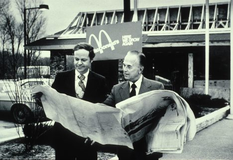 Fred Turner and Ray Kroc looking at blueprints of future McDonald's restaurant