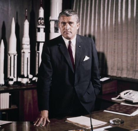 MSFC CENTER DIRECTOR VON BRAUN, WERNHER-DR. IN HIS OFFICE WITH ROCKET MODELS IN BACKGROUND. 5/18/64