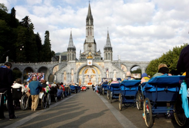 Handicapped pilgrims on wheelchairs face the Basilica of the Rosary as Pope Benedict XVI celebrates a special Mass for the sick in Lourdes, southwestern France, Monday, Sept. 15, 2008. The pope closed a visit to the Lourdes shrine reputed for its healing powers. His four-day trip to Paris and Lourdes was his first to France since his election as pontiff in 2005. (AP Photo/Alessandra Tarantino)