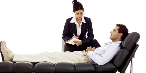portrait of a young female psychiatrist in session with a young male patient