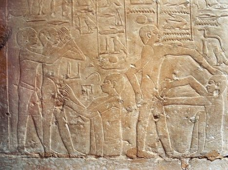 A detail of a relief in the tomb of Ankhmahor at Saqqara depicting a priest performing ritual circumcision on a young boy, Detail. Egypt. Ancient Egyptian. 6th dynasty c 2345 2181 BC. Saqqara.