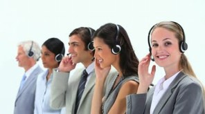 stock-footage-standing-business-people-speaking-into-headset-against-a-white-background